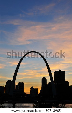 Saint Louis skyline during after sunset showing the arch on a vertical format