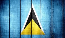 Saint Lucia Flag on old wood texture background