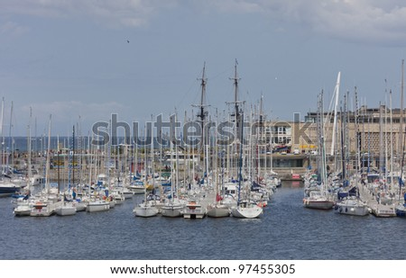 SAINT-MALO, FRANCE - JULY 6: Bassin Vauban Marina in Saint-Malo, France on July 6, 2011. This marina has moorings for 200 vessels and is located right under the city walls of Saint-Malo.