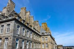 Saint-Malo - port city in Brittany. Architecture of the old city. Urban scene, city life.