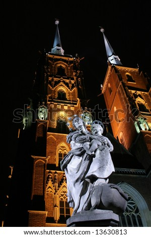 Saint marie with Jesus child, St. John`s Cathedral in background