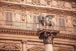 Saint Mark lion detail in Piazza delle Erbe in Verona in Italy
