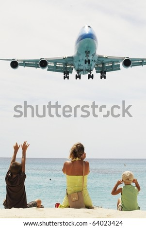 SAINT MARTIN, NETHERLANDS ANTILLES - APRIL 4: Maho beach near Princess Juliana International Airport. The airplane arrives over the full beach on April 5, 2010 in Saint Martin.