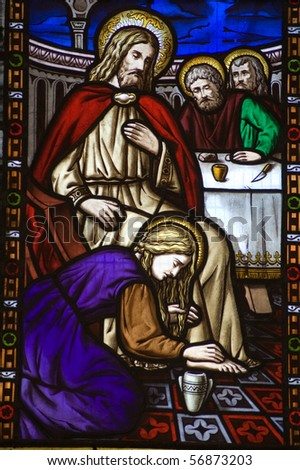 Saint Mary Magdalen footwashing Stained Glass Window A Victorian stained glass window depicting Saint Mary Magdalen anointing the feet of Jesus Christ and washing them with her hair.
