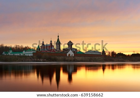 Saint Nicholas Monastery for Men in Staraya Ladoga.  View from a bank of Volkhov river at sunset. #639158662