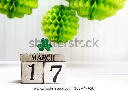 Saint Patricks Day green clover with wooden block calendar