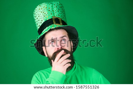 Saint patricks day holiday. Green part of celebration. Happy patricks day. Global celebration. St patricks day holiday known for parades shamrocks and all things Irish. Man bearded hipster wear hat.