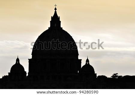 Saint Peter's Basilica dome silhouette in Vatican City, Rome.
