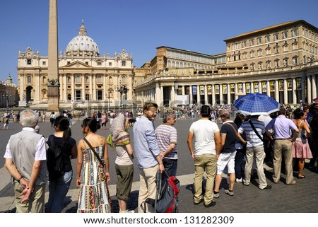 SAINT PETER'S BASILICA, ROME- JUNE 18: A large crowd of tourists and pilgrims, unidentified,waits in line to enter the Vatican Museums, June 18, 2011 in Rome, Italy.