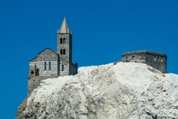 Saint Peter's Church (Chiesa di San Pietro) in Portovenere, a sea town in La Spezia, Italy, seen from Palmaria Island