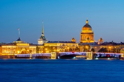 Saint Petersburg cityscape with St. Isaac's cathedral, Admiralty buildings and Palace bridge at night, Russia