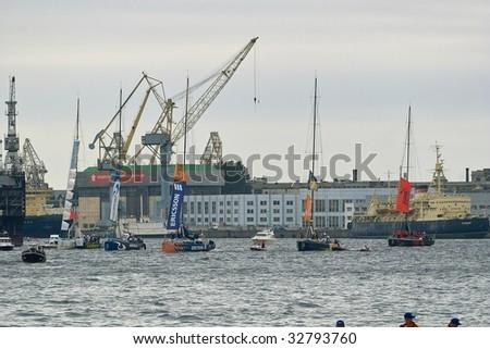 SAINT PETERSBURG - JUNE 27 : Participating yachts parade at Neva River during Volvo Ocean Race 2008-2009 June 27, 2009 in Saint Petersburg, Russia. - stock photo