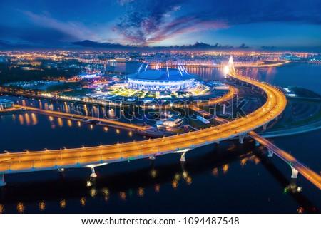 Saint-Petersburg,  Krestovsky Island. Russia. The Neva River flows into the Gulf of Finland. High-speed highway. Stadium. Evening Petersburg. Cities of Russia. Bridges of Petersburg.