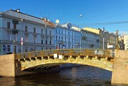 Saint Petersburg. Large Konyushenny arched bridge 1828 across the Moika River at summer sunset. Beautiful cityscape