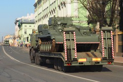 Saint Petersburg. Palace Embankment, transportation of heavy military equipment, tank, preparation for the Victory Parade on May 9. People watch the convoy