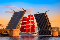 Saint Petersburg. Russia. A ship with scarlet sails passes under the Palace bridge. White nights in Saint Petersburg. Holiday Scarlet sails. The sailing ship on the Neva. Bridges Of St. Petersburg.