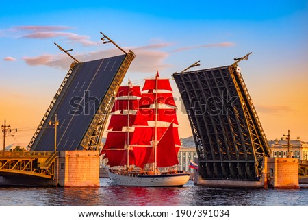 Saint Petersburg. Russia. A ship with scarlet sails passes under the Palace bridge. White nights in Saint Petersburg. Holiday Scarlet sails. The sailing ship on the Neva. Bridges Of St. Petersburg. Photo stock ©
