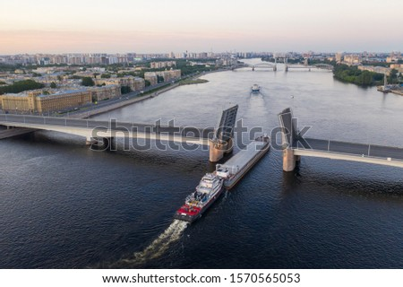 Saint Petersburg. Russia. Alexander Nevsky Bridge lifted. The drawbridges of Petersburg. Navigation on the Neva River. Cities of Russia. Panorama of St. Petersburg.