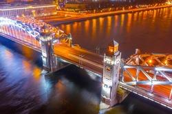 Saint Petersburg. Russia. Bolsheokhtinsky bridge in the night aerial view. Peter the Great bridge across the Neva