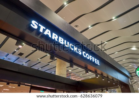 SAINT PETERSBURG, RUSSIA - CIRCA APRIL, 2017: Starbucks coffee shop at Pulkovo Airport. Starbucks Corporation is an American coffee company and coffeehouse chain. #628636079