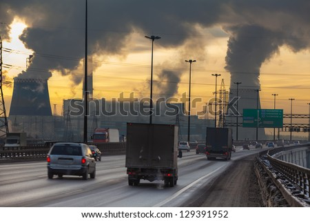 SAINT-PETERSBURG, RUSSIA-DECEMBER 23: City ringway with air pollution from heat electric generation plant on December 23, 2012 in Saint-Petersburg, Russia. Strong vapor and smoke due extreme cold