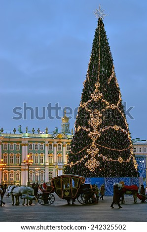 SAINT PETERSBURG, RUSSIA - JANUARY 5, 2015 : Christmas tree with illumination at Palace Square. Tourist horse carriage in front of Christmas tree.
