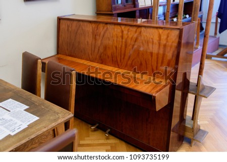 SAINT PETERSBURG, RUSSIA - MAY 18, 2018: Old piano. Exhibition dedicated to the children from Leningrad of the years 1920-30. #1093735199