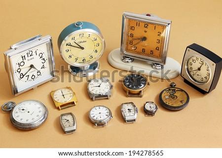 SAINT-PETERSBURG, RUSSIA -   May 17, 2014: Retro alarm clocks and watches (Soviet alarm clocks and watches brands Zaria, Slava, ZIM, Zvezda and  Swiss watch HY MOSER)