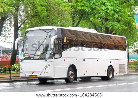 SAINT PETERSBURG, RUSSIA - MAY 26, 2013: White Jonckheere Arrow interurban coach at the city street.
