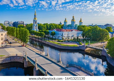 Saint Petersburg. Russia. Nicholas Naval Cathedral. St. Petersburg in sunny weather. Russian city on the background of blue sky. Orthodox church by the river. Neva. Tourism in Petersburg.