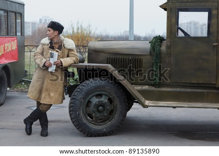 SAINT-PETERSBURG, RUSSIA – NOVEMBER 4: Military performance in celebration of National Unity Day. Soviet soldier standing near lorry on November 4, 2011 in Saint-Petersburg, Russia.