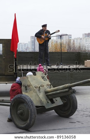 SAINT-PETERSBURG, RUSSIA – NOVEMBER 4: Military performance in celebration of National Unity Day. Three soviet soldiers reading newspapers on November 4, 2011 in Saint-Petersburg, Russia.