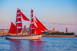 Saint Petersburg. Russia. Ship with scarlet sails on the background of Vasilievsky island. Brigantine with scarlet sails on the Neva. White nights in St. Petersburg. Holiday Scarlet sails.