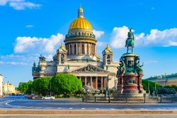 Saint Petersburg. Russia. The center of Petersburg on a Sunny summer day. St. Isaac's Cathedral against the blue sky. Monument to Emperor Nicholas I on St. Isaac's square. Architecture Of Petersburg