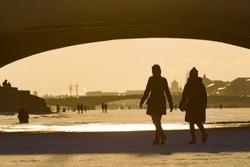 Saint Petersburg. Russia. Walk on the frozen Neva. People walk on the ice under the bridges. Rivers Of St. Petersburg. Winter fishing. Black and white photo. Winter in Russia. Trip to St. Petersburg.