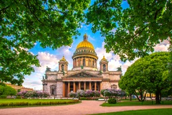 Saint Petersburg. Saint Isaac's Cathedral. Museums of Petersburg. St. Isaac's Square. Summer in St. Petersburg. St. Isaac's Cathedral in the crowns of trees. Russia.