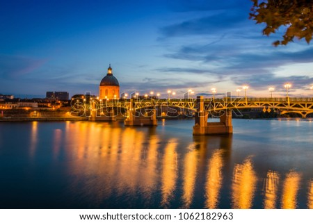 Saint Pierre bridge and the Hospital of la Grave on the Garonne river in Toulouse at sunset, France #1062182963