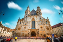 Saint Stephen's Cathedral on the central square in Vienna. Long exposure image technic with blurred people and clouds