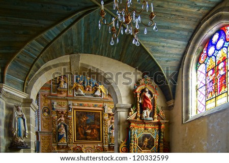 SAINT-THEGONNEC,FRANCE-AUGUST 15:Interior of the temple.Sculptured of granite in the naive style.Impressive sculptured monuments are the best form of Breton art;Aug 15,2012 in Saint-Thegonnec,France