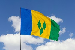 Saint Vincent and the Grenadines flag isolated on sky background with clipping path. close up waving flag of Saint Vincent and the Grenadines. flag symbols of Saint Vincent and the Grenadines.