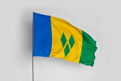 Saint Vincent and the Grenadines flag isolated on white background with clipping path. close up waving flag of Saint Vincent and the Grenadines. flag symbols of Saint Vincent and the Grenadines.