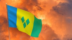 Saint Vincent and the Grenadines flag on pole. Dramatic background. National flag of Saint Vincent and the Grenadines