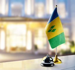 Saint Vincent flag on the reception desk in the lobby of the hotel