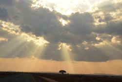 Sakaraha, Madagascar. September 2018. The sun breaking through the clouds on to the plains of Southern Madagascar.