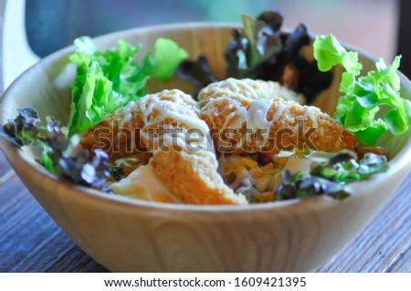 salad, fried shrimp salad with salad dressing topping