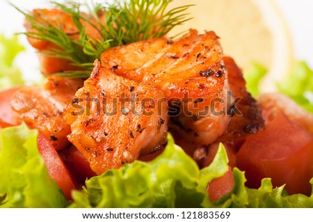 Salad from a fried salmon with a lemon and fennel - stock photo