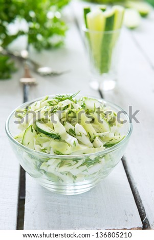 Salad from fresh cabbage, cucumber and dill