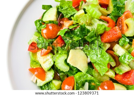 Salad from fresh vegetables with an olive oil on a white background , saved clipping path
