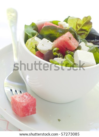 Salad from lettuce, watermelon and feta in cup