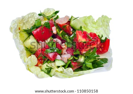 salad from tomatoes and seafood in a cabbage leaf on a white background